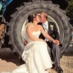 The Flying Fish Wedding Barn bride and groom with tractor 14
