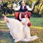 The Flying Fish Barn bride in red chair with bottle 11