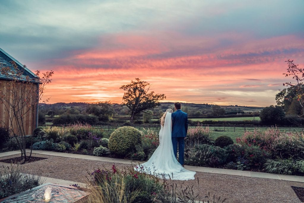 Wedding venue types - couple overlooking a sunset