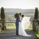 Healey Barn Wedding Venue Newcastle Northumberland outside couple kiss