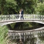 Morden Hall Morden Hall Couple on the bridge at a 18th Century country house wedding venue 37
