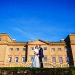 Hagley Hall Tank & Dohil Bride &Groom on Ha Ha with HH in background resize min 1