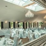 Barton Hall wedding venue Northamptonshire dining area tables chairs