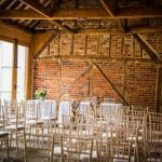 Stanlake Park & Vineyard wedding venue Berkshire couple indoors chairs