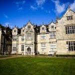Wakehurst Mansion blue sky min 2