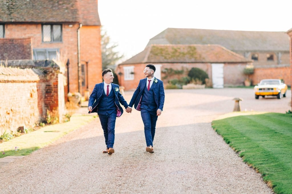 Lillibrooke Manor & Barns wedding venue outdoor shot holding hands