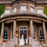 Wood Hall Hotel external front couple.jpg 14