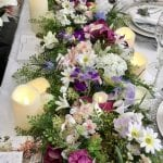 Floral table runner whose sides cascade to the floor