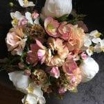 Wedding bouquet in warm peach shades