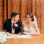 Layer Marney Tower Layer Marney Tower Andy Chambers Ian and Gemma signing register in wedding ceremony room.jpg 4