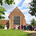 Layer Marney Tower Wedding guests in garden at Layer Marney Tower.JPG 21