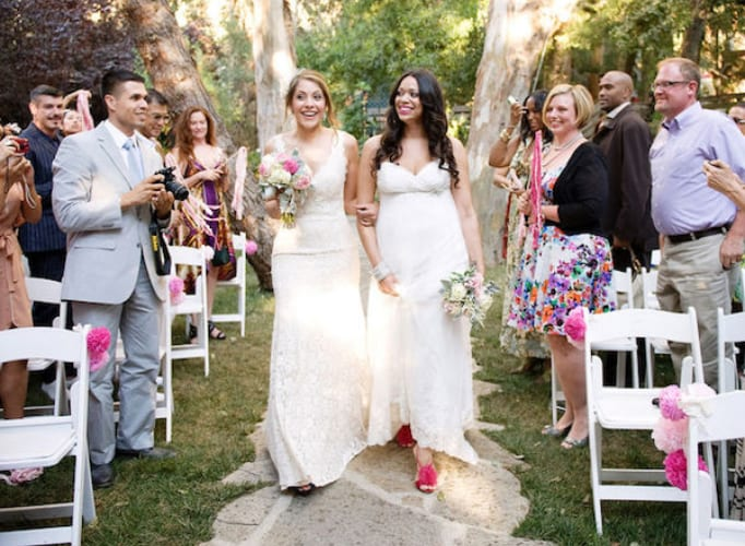 Tips For The Perfect LGBTQ Wedding Walk down aisle credit Next Exit Photography 1