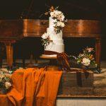 The Tithe Barn wedding cake on the stage.jpg 4